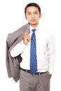 Confident businessman with jacket draped over shoulder Royalty Free Stock Photo