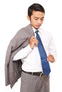 Confident businessman with jacket draped over shoulder, Royalty Free Stock Photo