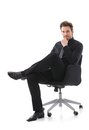 Confident businessman sitting on chair smiling Royalty Free Stock Photo