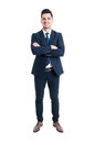 Confident businessman standing with arms crossed and smiling Royalty Free Stock Photo
