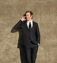 Confident businessman talking on mobile phone outdoors close up portrait of a Royalty Free Stock Image