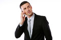 Confident businessman talking on the phone over white background Royalty Free Stock Photography