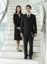 Confident businesspeople standing on staircase full length portrait of two stairs Royalty Free Stock Images