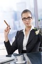 Confident businesswoman with cigar Royalty Free Stock Photography