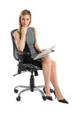 Confident businesswoman with file sitting on office chair full length portrait of isolated over white background Stock Images
