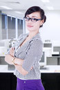 Confident businesswoman her arms crossed office Stock Images