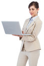 Confident businesswoman holding laptop against white background Stock Photo