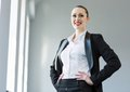 Confident businesswoman image of young attractive in business suit smiling Royalty Free Stock Photography
