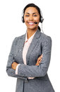 Confident customer service representative wearing headset portrait of female with arms folded against white background vertical Stock Image