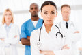 Confident doctor leading her team. Royalty Free Stock Photo