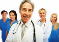 Confident doctor with other colleagues at the back Royalty Free Stock Photography