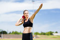 Confident female athlete preparing to throw shot put ball Royalty Free Stock Photo