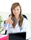 Confident female doctor looking at the camera Royalty Free Stock Photo
