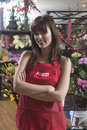 Confident female florist standing arms crossed portrait of in shop Stock Photos