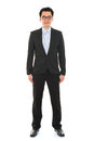 Confident full body asian business man in formal suit standing isolated on white background Stock Photo