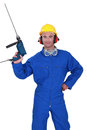 Confident handyman hand man with power drill Royalty Free Stock Photography