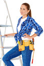 Confident happy diy handy woman with a tool belt round her waist isolated on white Royalty Free Stock Images
