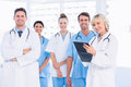 Confident happy group of doctors at medical office portrait standing the Royalty Free Stock Photo