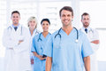 Confident happy group of doctors at medical office portrait standing the Royalty Free Stock Image