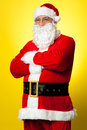 Confident male Santa posing with arms folded Royalty Free Stock Images