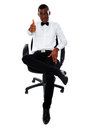 Confident man with thumbs-up gesture Stock Image