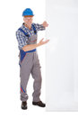 Confident Manual Worker Holding Billboard Royalty Free Stock Photo