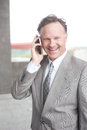 Confident mature businessman on phone Stock Photo