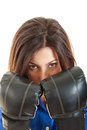 Confident modern business woman with boxing gloves close up of young ready to fight in over white background Stock Image