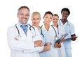 Confident multiethnic medical team standing in row portrait of over white background Royalty Free Stock Images