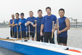 Confident outrigger canoeing team group portrait of multiethnic Stock Images