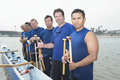 Confident outrigger canoeing team group portrait of multiethnic Royalty Free Stock Photography