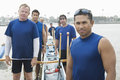 Confident outrigger canoeing team portrait of male rower with multiethnic Stock Photos