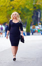 Confident overweight woman walking the city street attractive alone Stock Photos