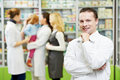 Confident pharmacy chemist man in drugstore Stock Photos