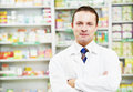 Confident pharmacy chemist man in drugstore Stock Images