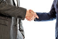 Confident relaxed businessman shaking hands with his hand in his suit pocket with businesswoman to conclude a deal agreement Royalty Free Stock Photos