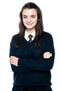Confident schoolgirl posing with folded arms Royalty Free Stock Photography