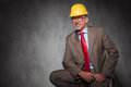 Confident senior engineer wearing helmet and glasses, smiling Royalty Free Stock Photo