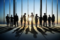 Confident Silhouette Of Business People Posing For The Camera In Royalty Free Stock Photo