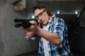 Confident skilled shooter pulling the trigger Royalty Free Stock Photo