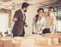 Confident team of engineers working together in a architect stud studio Stock Photo