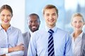 Confident team portrait of a with a handsome leader Royalty Free Stock Images