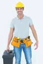 Confident technician holding tool box portrait of over white background Stock Photo