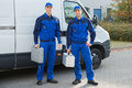 Confident Technicians Standing Against Truck Royalty Free Stock Photo