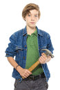 Confident teenage boy holding a hammer with both hands isolated on white Stock Photo