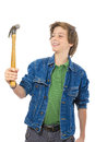 Confident teenage boy smiling to a hammer in his hand isolated on white Royalty Free Stock Image