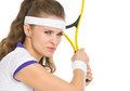 Confident tennis player ready to hit ball Royalty Free Stock Photo
