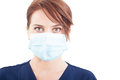 Confident woman doctor face wearing surgical mask on white background Stock Photo