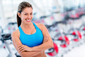 Confident woman at the gym with arms crossed and smiling Royalty Free Stock Photos