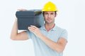 Confident worker carrying tool box on shoulder portrait of over white background Royalty Free Stock Photos